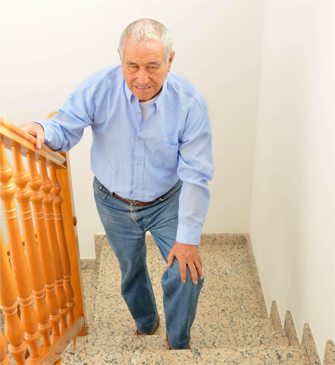 man struggling to walk up stairs